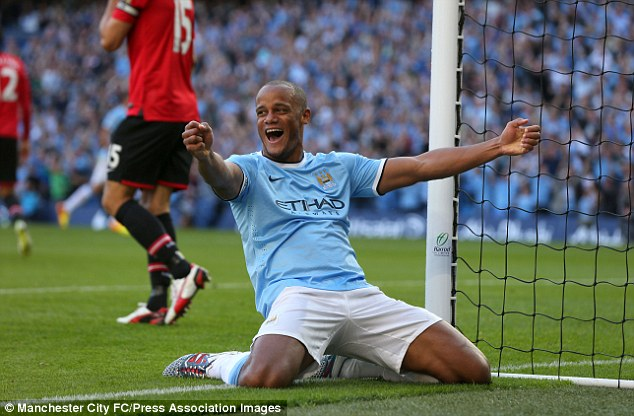 Kompany celebrates before the fans