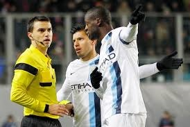 Yaya Toure pleads with the referee to action as the CSKA fans chant racicst taunts
