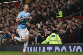 Edin Dzeko wheels away after the opener at Old Trafford last year after just 44 seconds. City need to make it four in a row there this month