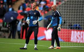The Gaolkeeping Fraternity. City's 1 and 2 share a joke during a warm up